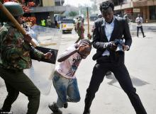 A Kenyan Military officer trying to hit a journalist with a big stick during 2017 presidential elections.