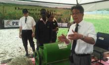 Dr. kazuhiko explainig how a rice thresher works